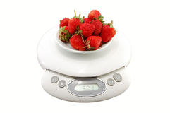 Strawberries in bowl on the scales Royalty Free Stock Photos