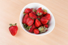 Strawberries in a bowl on the table Royalty Free Stock Images