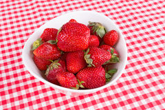 Strawberries in a bowl on the table Royalty Free Stock Photography