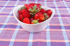 Strawberries in a bowl on the table Royalty Free Stock Photos