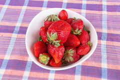 Strawberries in a bowl on the table Stock Photo