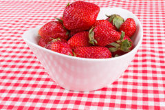 Strawberries in a bowl on the table Stock Images