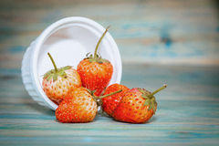 strawberries in bowl on wood Stock Photography