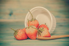 Strawberries in bowl on wood Royalty Free Stock Images
