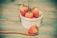 strawberries in bowl on wood Stock Photos