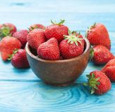 Strawberries in bowl on wooden background Royalty Free Stock Images