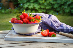 Strawberries in a Bowl . Strawberries in a Bowl on a wooden table Royalty Free Stock Image