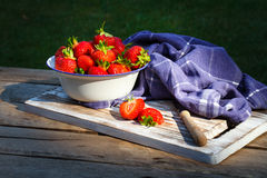 Strawberries in a Bowl . Strawberries in a Bowl on a wooden table Stock Images