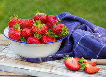 Strawberries in a Bowl . Strawberries in a Bowl on a wooden table Stock Photography