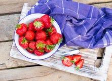 Strawberries in a Bowl . Strawberries in a Bowl on a wooden table Stock Photos