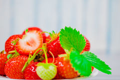 Strawberries in bowl on wooden table with low key and copy spacen Royalty Free Stock Photo