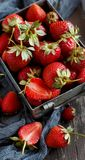 Strawberries in a box on a  table. Strawberries in a box  on a white wooden table Royalty Free Stock Photo