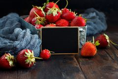 Strawberries in a box on a  table. Strawberries in a box  on a white wooden table Stock Images