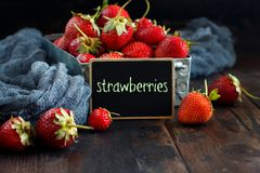 Strawberries in a box on a  table. Strawberries in a box  on a white wooden table Stock Photos