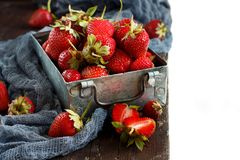 Strawberries in a box on a  table. Strawberries in a box  on a white wooden table Royalty Free Stock Photos