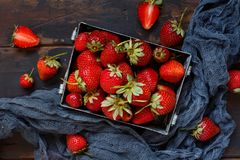 Strawberries in a box on a  table. Strawberries in a box  on a white wooden table Stock Photography