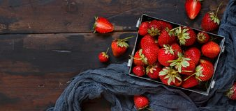 Strawberries in a box on a  table. Strawberries in a box  on a white wooden table Stock Image