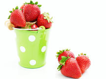 Strawberries  in bucket. Strawberries in green bucket on the white Royalty Free Stock Image