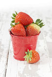 Strawberries in a bucket Stock Photos