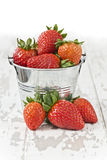 Strawberries in a bucket Stock Images
