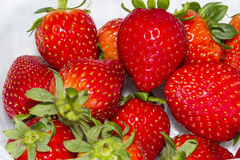 Strawberries. Bunch of ripe strawberries on white table Royalty Free Stock Photo