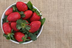 Strawberries on burlap Stock Image