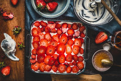 Strawberries cake, cooking preparation with ingredients and kitchen tools. Top view Stock Images