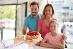Strawberries cake for girl with parents in confectionery royalty free stock photos