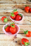 Strawberries and cake pans Stock Image
