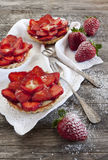 Strawberries cakes french tartellette with strawberries and pastry cream Royalty Free Stock Photography