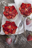 Strawberries cakes french tartellette with strawberries and pastry cream Stock Photos