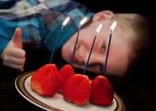 Toddler boy fourth birthday celebration stock photos