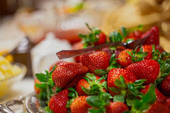 Strawberries at catered wedding reception. Catered wedding reception with strawberries, chocolate, punch, fruit, nuts, cheese Stock Images
