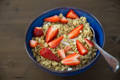 Strawberries and cereal in bowl for healthy breakfast. Healthy breakfast bowl on table Royalty Free Stock Photos
