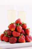 Strawberries and champagne glasses Stock Photography