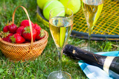 Strawberries, champagne and tennis balls Royalty Free Stock Images