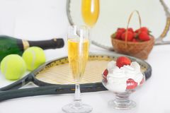 Strawberries and champagne with tennis equipment on Wimbledon tournament. Wimbledon Grand slam celebration concept royalty free stock photo