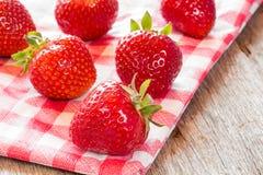 Strawberries on checkered napkin. Stock Photos