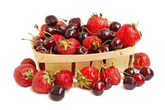 Strawberries and cherries in a basket Royalty Free Stock Photo