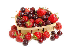 Strawberries and cherries in a basket Royalty Free Stock Photography