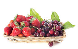 Strawberries and cherries in basket Royalty Free Stock Images