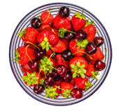 Strawberries and Cherries in a Glass Bowl. Studio shot Stock Image