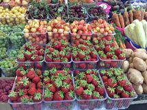 Strawberries, cherries and other berries for sale in food market, Moscow. Fresh berries and some vegetables for sale on local food market. Moscow, Russia royalty free stock photography
