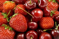 Strawberries and cherries on white background Royalty Free Stock Photo