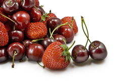 Strawberries and cherries on white background Stock Photos