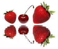 Strawberries and Cherry. Over Water with Reflections Stock Photography