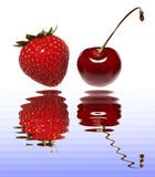 Strawberries and Cherry. Strawberry and Cherry over Water with Reflections Royalty Free Stock Images