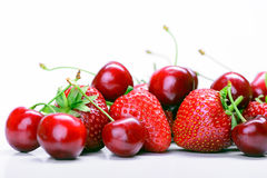 Strawberries and cherry Stock Images