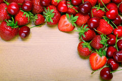 Strawberries and cherry Royalty Free Stock Photography