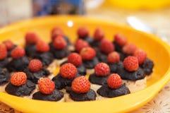 Strawberries, chocolate and a banana Royalty Free Stock Image